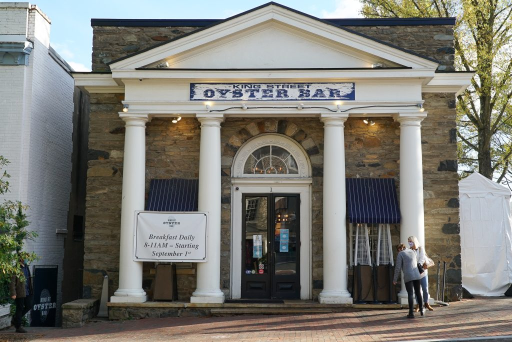Building with white columns and a sign that says King Street Oyster Bar