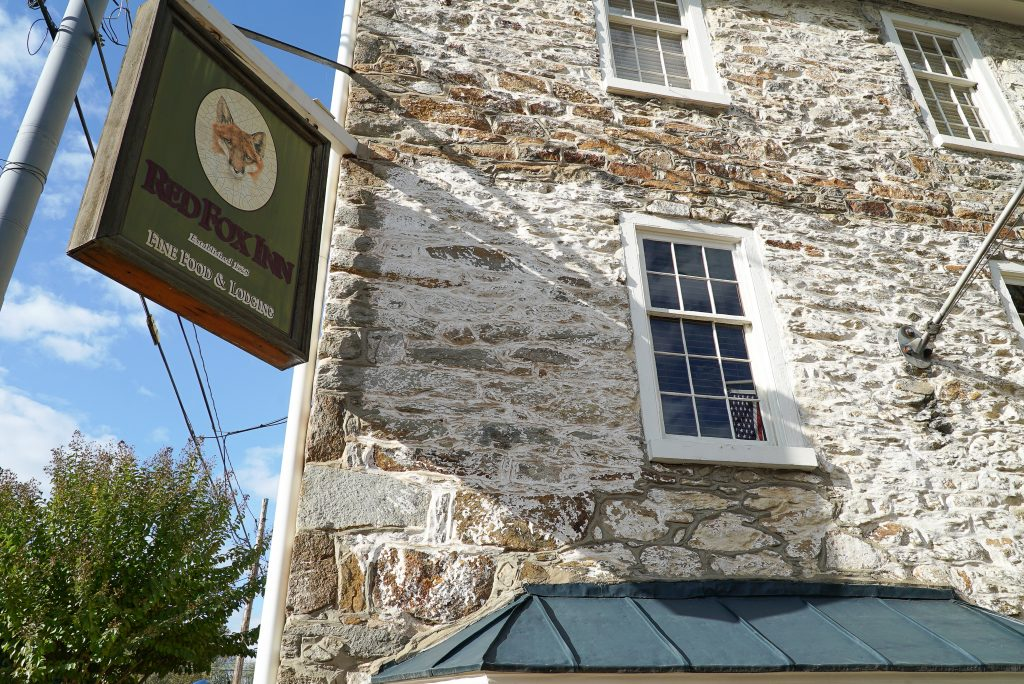 Stone building with sign that says Red Fox Inn and Tavern - this is one of the best places to eat in Middleburg Virginia