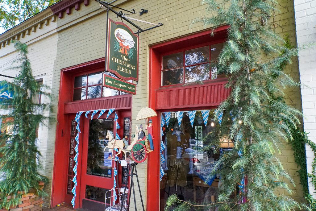 Christmas gift shop with red door and green wreath - Christmas Sleigh shop