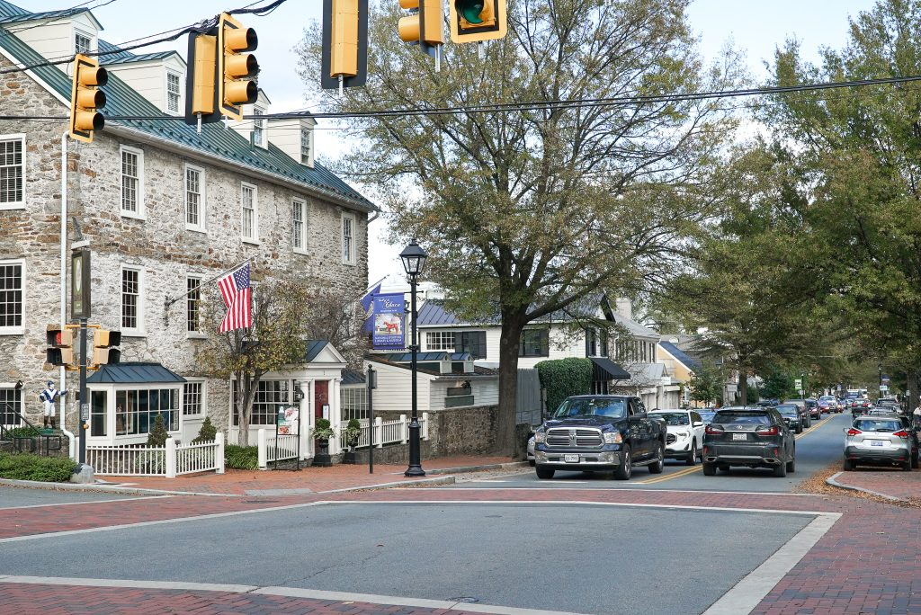 Stone inn with cars stopped at a stop light - How to plan a spectacular trip to Middleburg Virginia