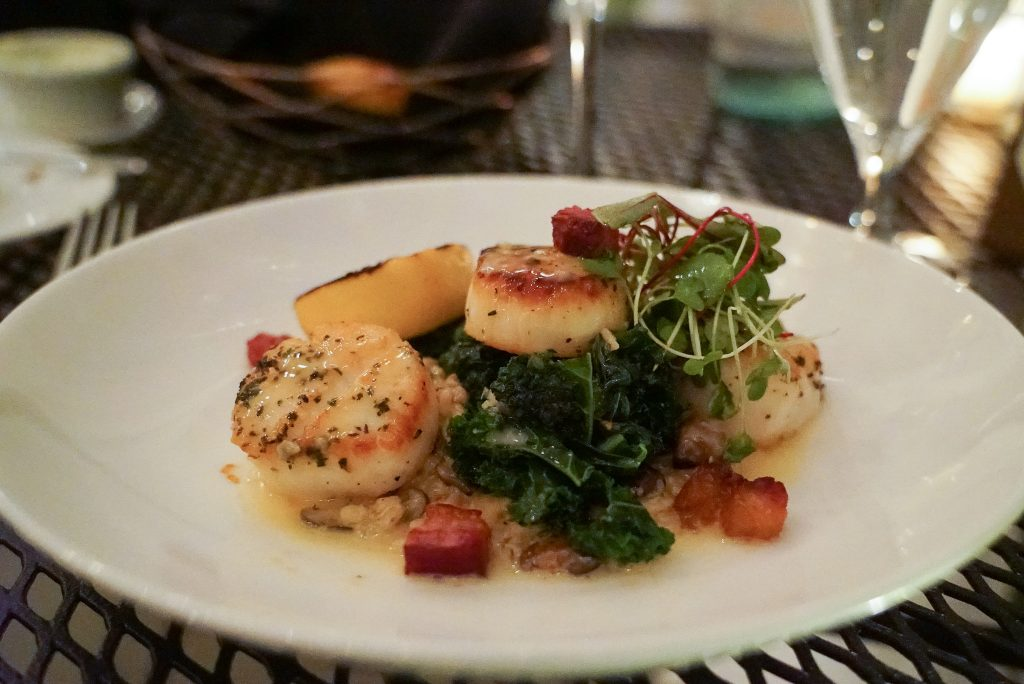 Scallops on a white plate at the Red Fox Inn and Tavern in Middleburg Virginia