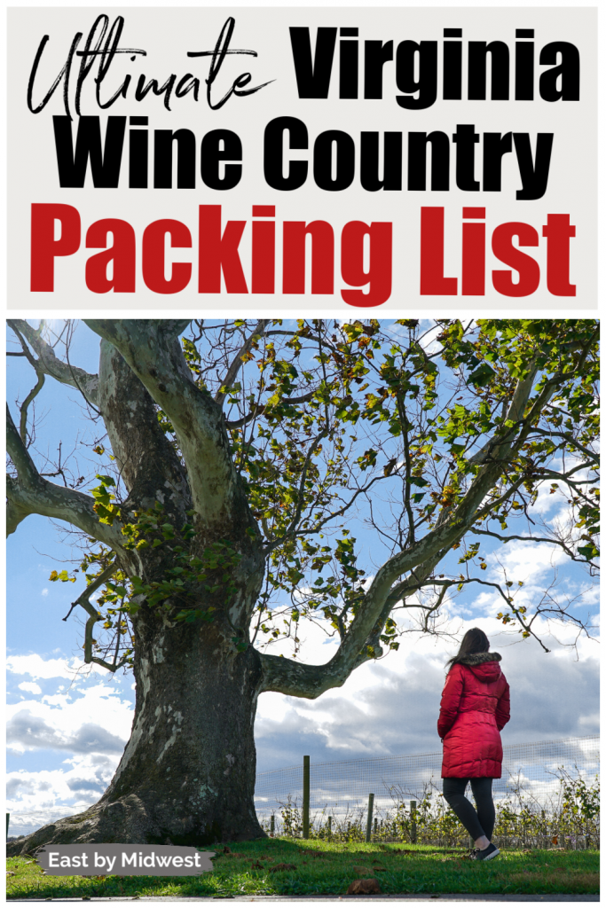 Woman in red coat standing next to tree with grape vines in the background - What to pack for Virginia wine country