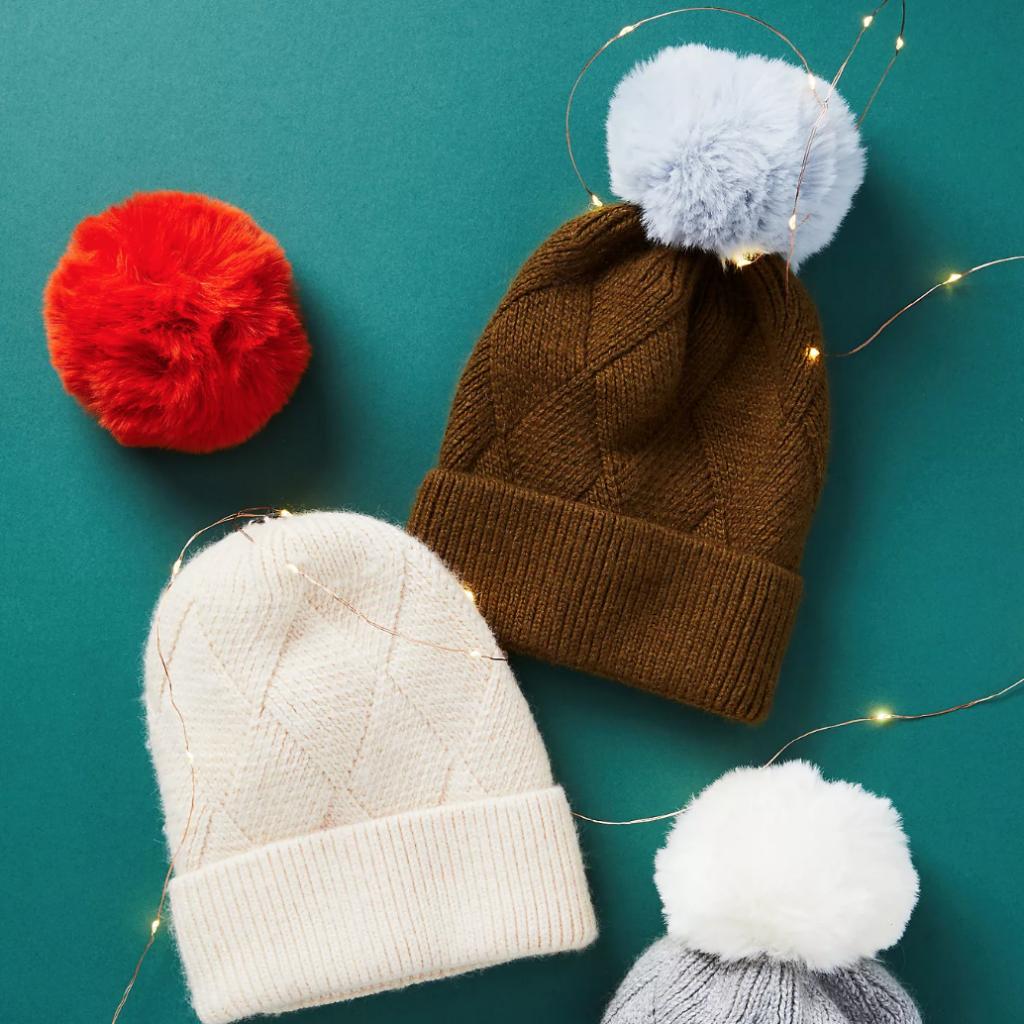 Three hats with pom poms