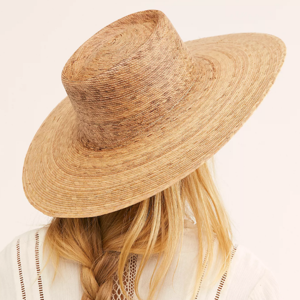 Straw hat on woman with blonde hair