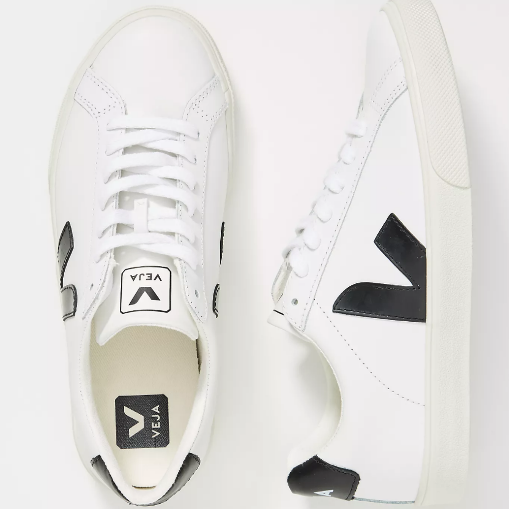 White leather shoe with black detailing - France packing guide