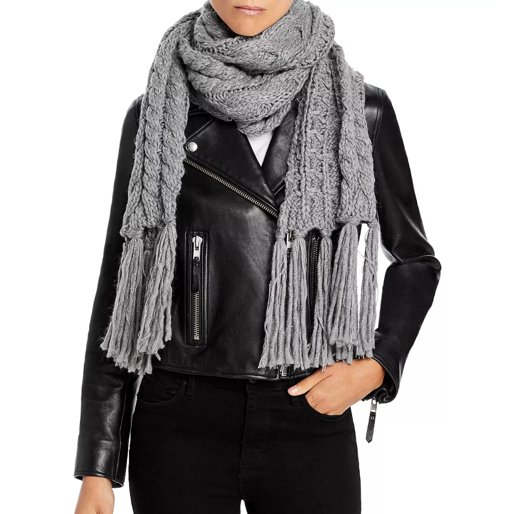Woman wearing gray scarf and black jacket