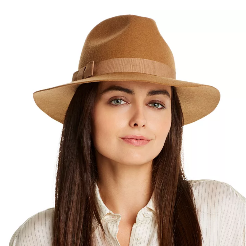 Tan hat on woman with brown hair