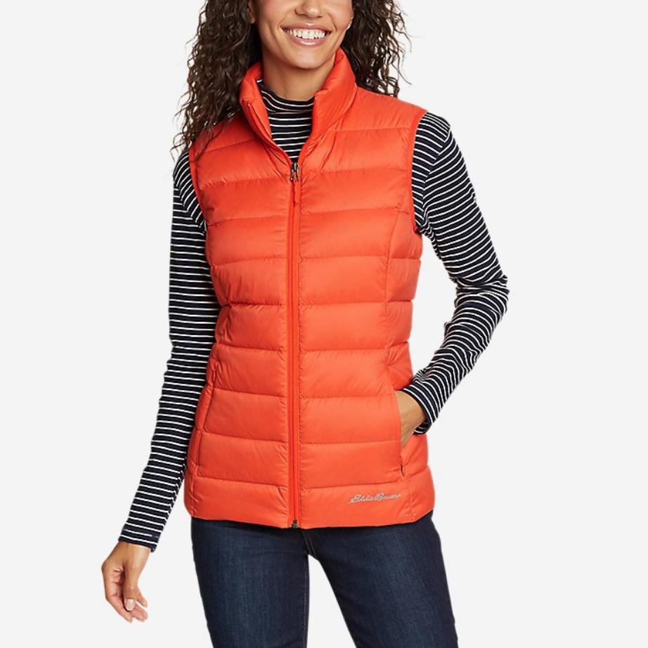 Woman wearing orange vest