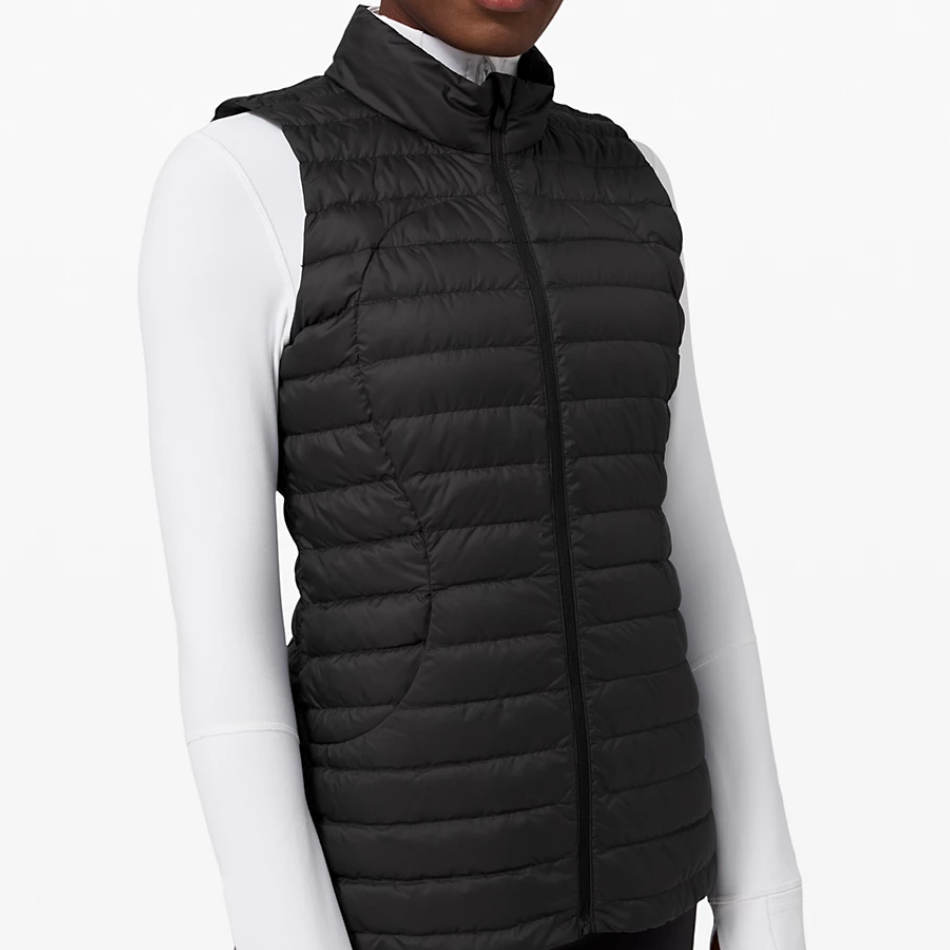 Woman wearing black vest