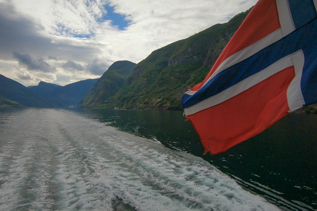 Fjord and Norway Flag - Ultimate Norway Guide
