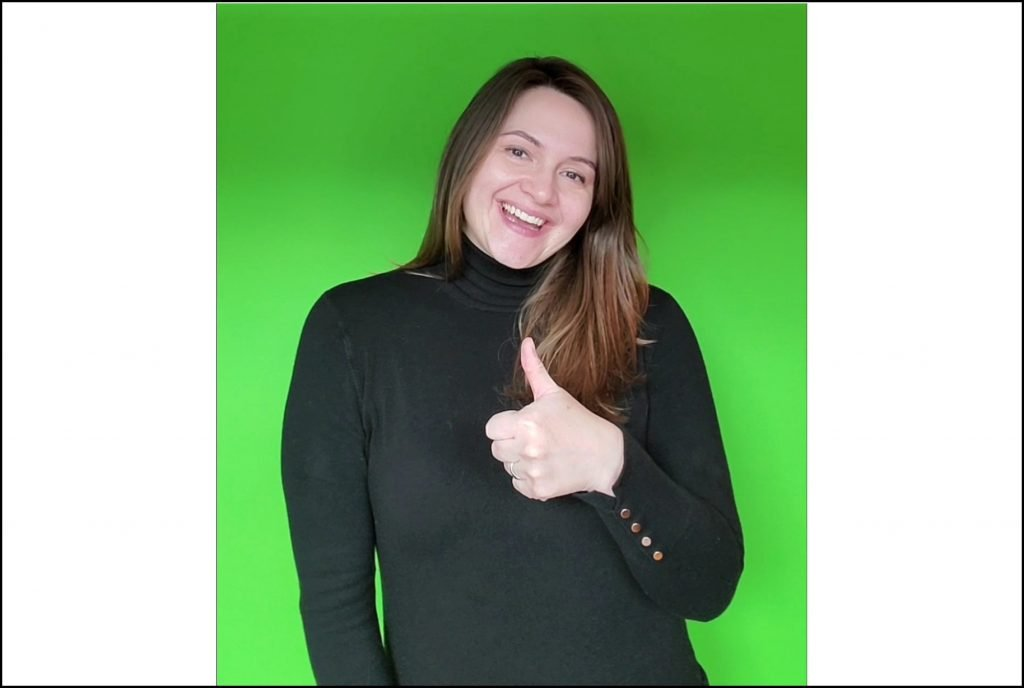 Woman in Black Turtleneck with Green Background - How to Turn Yourself into a GIF